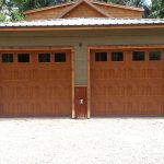 Photo of 2 wood residential garage doors