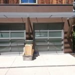 Photo of 2 grey metal residential garage doors